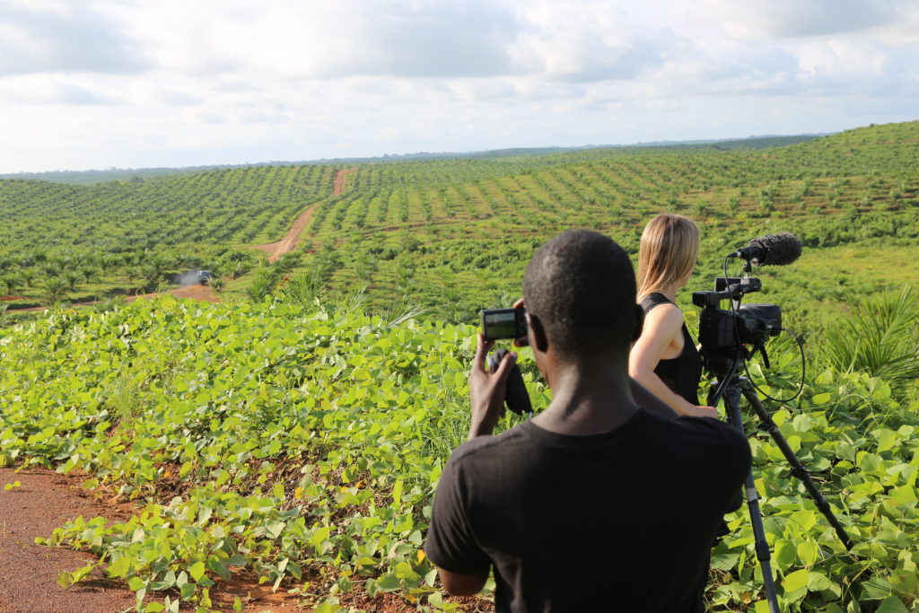Filming on the Sime Darby concession, a monoculture landscape of newly planted oil palm in Grand Cape Mount county, Liberia. With Emmanuel Urey and Sarita Siegel. Gregg Mitman, June 12, 2014.