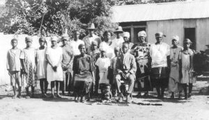 Of nearly 600 photographs taken on the expedition, this family portrait is only one of two taken of Plenyono Gbe Wolo, who is seated on the right. Loring Whitman, 23 July 1926. Courtesy Indiana University Liberian Collections.
