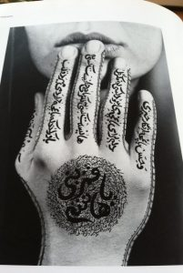 Untitled work by Shirin Neshat, Berkeley educated, Iranian American. Poet: Forough Farrokhzad. In Daftari.